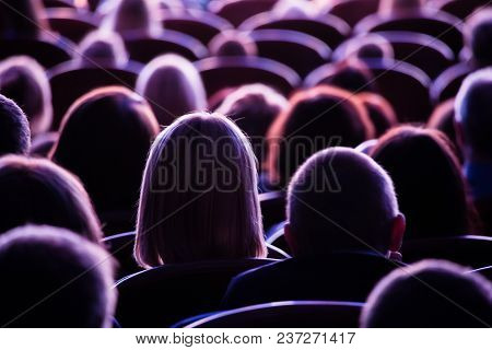 Spectators In The Theater Or In The Cinema. Children And Adults. Full House.