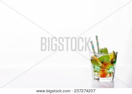 Colorful Cocktails Garnished With Citrus, Alcoholic Beverage And Cocktail In Elegant Glasses On A Wh