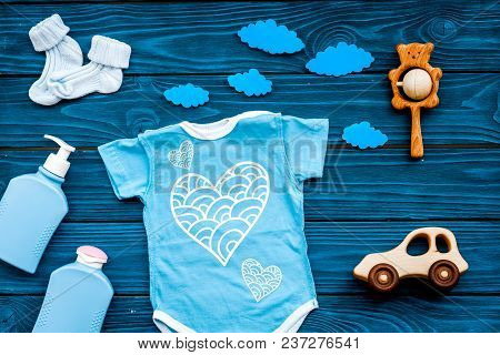 Newborn Baby's Sleep Concept. To Put The Child To Bed. Baby Bodysuit Near Clouds And Cbaby Accessori