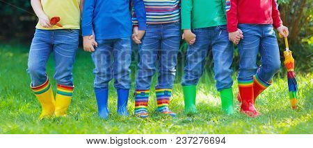 Kids In Rain Boots. Group Of Kindergarten Children In Colorful Rubber Boots And Autumn Jackets. Foot