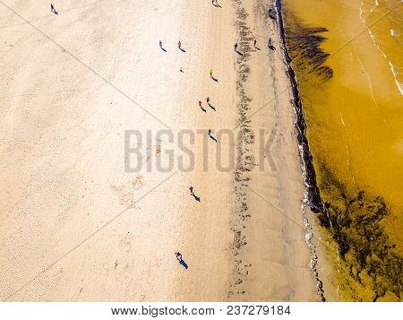 Aerial View From Drone On People Are Running On Marathon Event By The Sea Shore In Jurmala, Latvia.
