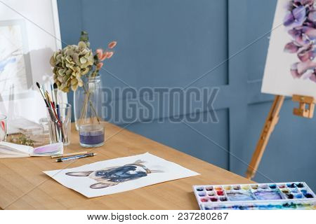 Crafty Room. Artful Studio. Creative Painter Workspace. Paintings Drawings And Watercolors On The Ta