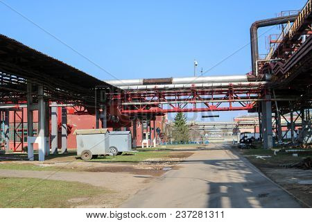Pipeline Overpass With Pipes For Pumping Liquid At An Oil Refinery, Petrochemical Plant.