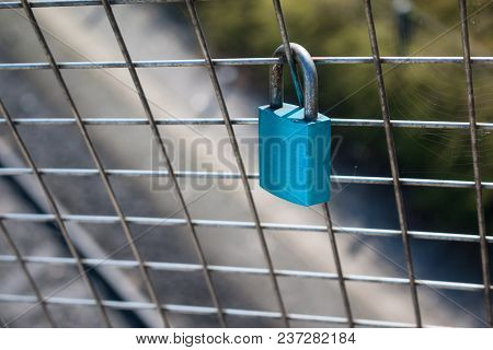 Aged Rusty Metallic Lock Chained With A Love Message Writted On His Surface And A Blurred Blue And C