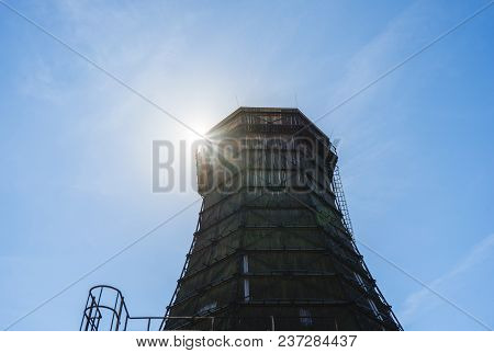 Old Wooden Cooling Tower Of Coking Plant On The Grounds Of The Zeche Zollverein With Sun And Blue Sk