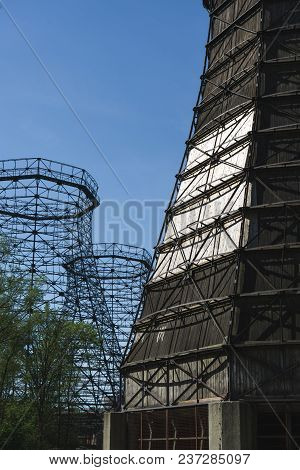 Old Wooden And Steel Cooling Tower Of Coking Plant On The Grounds Of The Zeche Zollverein With Sun A