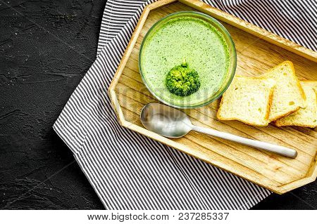 Natural, Organic Food. Green Vegetable Soup-puree In Bowl Ready To Eat Served With Rusks On Black Ta