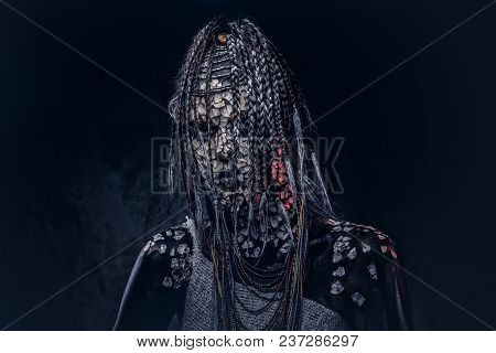 Portrait Of A Scary African Shaman Female With A Petrified Cracked Skin And Dreadlocks On A Dark Bac
