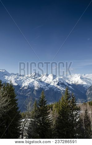 Sunny French Alps Landscape  And Snowy Mountain View In Les Arcs Ski Resort Near Bourg Saint Maurice
