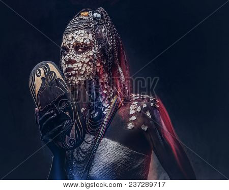 Close-up Portrait Of An African Shaman Female From The Indigenous African Tribe, Wearing Traditional