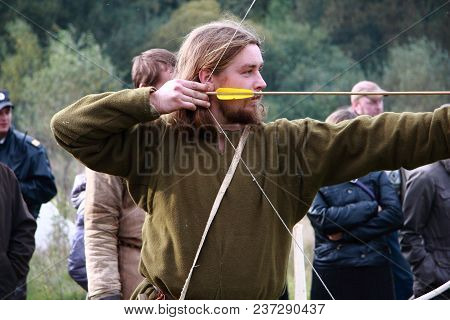 Russia, Bryansk, 2 October 2010. Reconstruction Of Historical Chronicles. The Archer Holds The Bow A