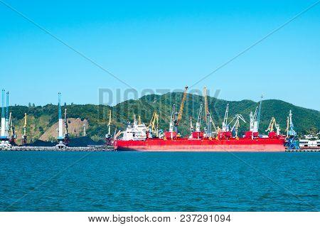 Big Red Ship On A Shipyard Industrial Marine Background
