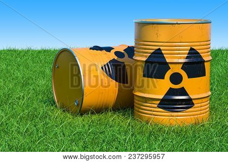 Barrels With Radioactive Waste On The Green Grass Against Blue Sky, 3d Rendering