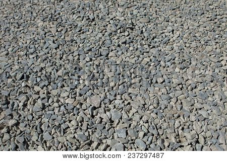 Small Rock Textured Background. Seamless Texture Of Gravel. Crushed Granite.