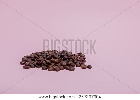 Coffee Beans On A Pink Background Free Space For The Inscription On The Right.