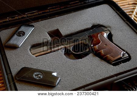 A Handgun Is Presented From The Inside Of A Lock Box.