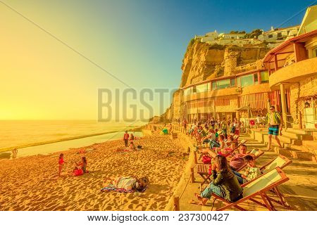 Azenhas Do Mar, Portugal - August 5, 2017: Tourists Sunbathing And Relaxing On Famous Beach Of Azenh