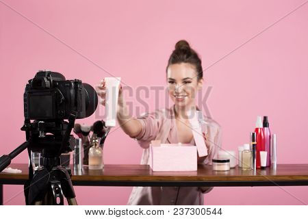 Famous Blogger. Cheerful Female Vlogger Is Showing Cosmetics Products While Recording Video And Givi