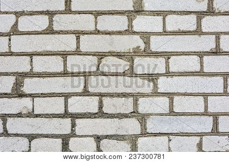 Background, Structure. A Wall Of Gray Bricks In Cement Mortar