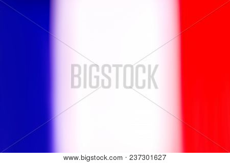 The Flag Of France In Defocus. Horizontal Frame