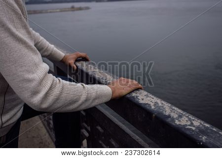 Depressed Frustrated Man Is Going To Jump From Bridge. Suicide And Despair Concept.
