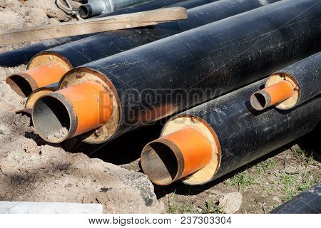 Steel Pipes With Heat Insulation On The Street