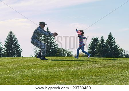 Girl Running To Her Military Father, Side View. Reunion Of A Soldier And His Daughter, Daddy Is Back