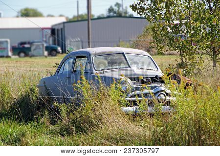 Fairland, Ok - October 09: Old Used Car Parked In Rural Vacant Lot 2013