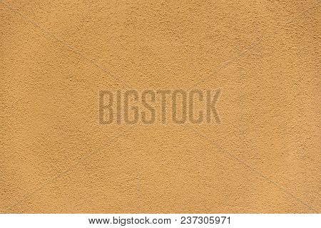 Golden Texture Wall Background. Yellow Textured Wall.
