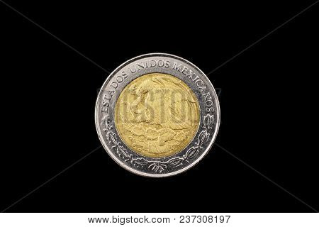 A Macro Image Of A Mexican One Peso Isolated On A Black Background