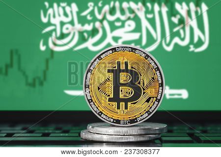 Bitcoin (btc) Cryptocurrency; Coin Bitcoin On The Background Of The Flag Of Saudi Arabia (ksa)