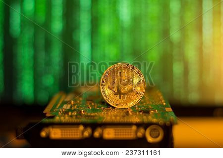 Bitcoin Mining Graphic Card On A Blurry Matrix Background