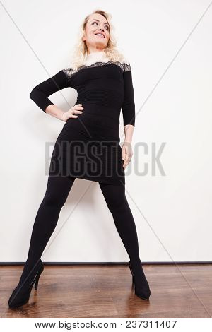 Autumn Winter Outfit Concept. Mid Adult Blond Attractive Woman In Full Length Wearing Stylish Elegan