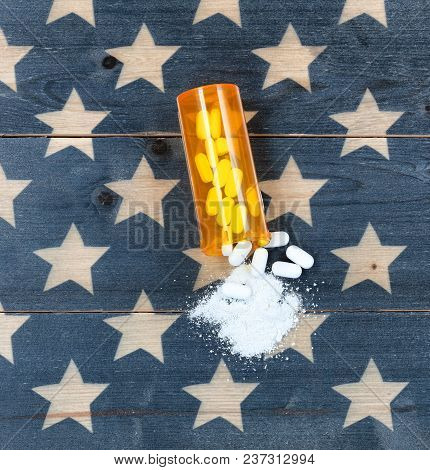 Overhead View Of Prescription Bottle Filled With Generic Opioid Pain Killer Tablets On Rustic Usa Fl