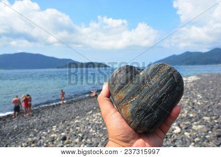 Heart Shaped Stone In Hand,  Koh Hin Ngam , Tarutao Marine National Park In Satun Province, Thailand