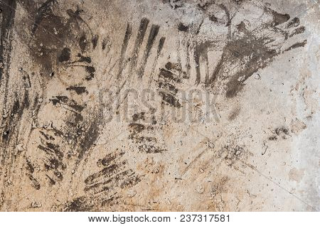 Dirty imprints of human hands on wall concrete