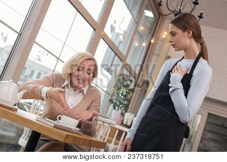 So Disgusting. Angry Aged Woman Talking To The Waitress And Telling Coffee Is Awful