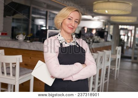 My Job. Pretty Aged Waitress Smiling And Standing In The Cafe