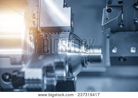 The Cnc Turning Or Lathe Machine Cutting The Thread At The End Of Metal Cone Shape Part In The Light