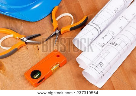 Diagrams Or Electrical Construction Drawings, Protective Blue Helmet And Orange Work Tools For Engin
