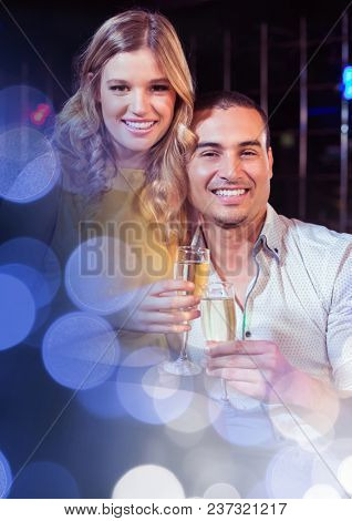 Couple having fun celebration party with sparkling lights bokeh transition