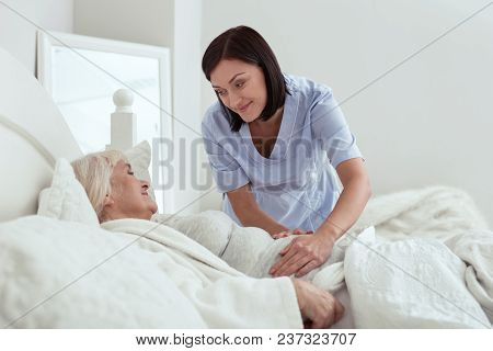 Stomach Discomfort. Pleasant Happy Touching Stomach While Elder Woman Resting In Bed