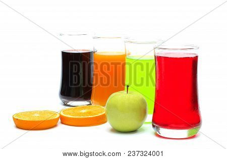 Orange , Apple , Grape And Strawberry Juice In Glass , Ripe Orange And Ripe Green Apple  On White Ba