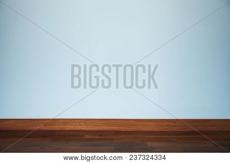 Light Blue Wall With Wood Floor Using For Background