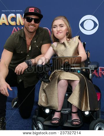 LAS VEGAS - APR 15:  Kip Moore, Make a wish guest at the Academy of Country Music Awards 2018 at MGM Grand Garden Arena on April 15, 2018 in Las Vegas, NV