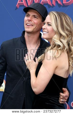 LAS VEGAS - APR 15:  Granger Smith, Amber Bartlett at the Academy of Country Music Awards 2018 at MGM Grand Garden Arena on April 15, 2018 in Las Vegas, NV