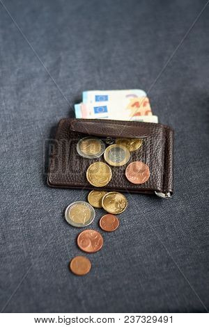 An Image Of A Purse With Money On Gray Background