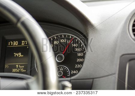 Close Up Interior View Of Modern Luxurious Black Car. Dashboard, Steering Wheel, Speedometer. Speed,