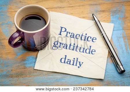 Practice gratitude daily reminder - inspirational handwriting on a napkin