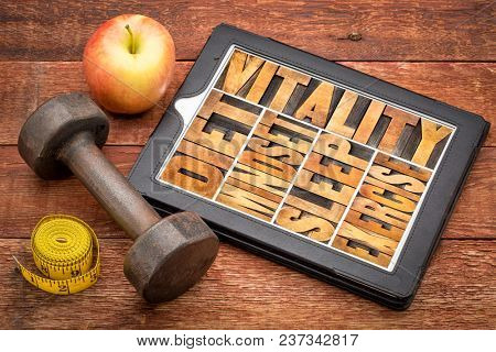diet, sleep, exercise and mindset - vitality concept - word abstract in vintage letterpress wood type on a digital tablet with a dumbbell, apple and tape measure poster